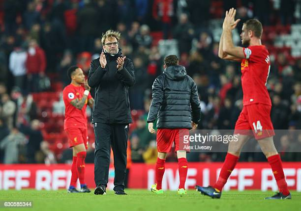 Jurgen Klopp manager of Liverpool and Jordan Henderson of Liverpool celebrates victory after the Premier League match between Liverpool and Stoke...