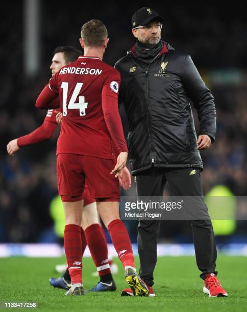 Jurgen Klopp Manager of Liverpool and Jordan Henderson shake hands after the Premier League match between Everton FC and Liverpool FC at Goodison...
