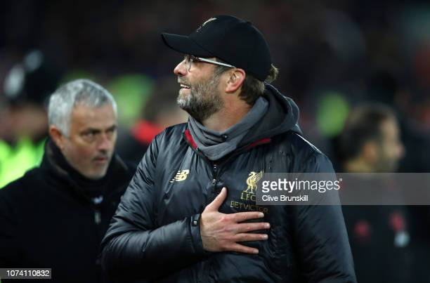 Jurgen Klopp Manager of Liverpool and Jose Mourinho Manager of Manchester United looks on prior to the Premier League match between Liverpool FC and...