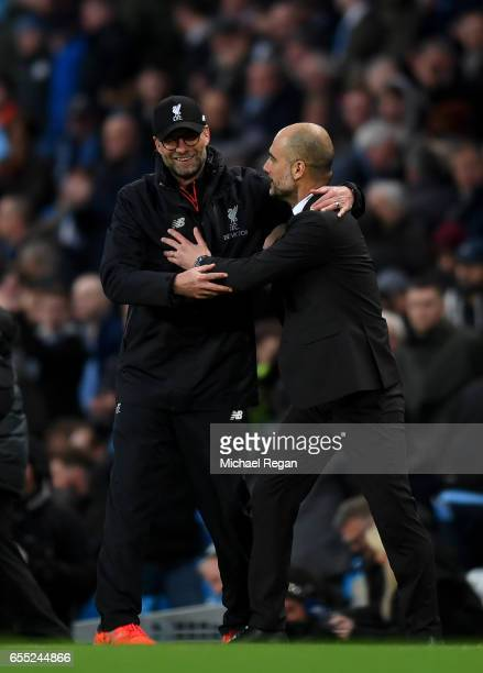 Jurgen Klopp Manager of Liverpool and Josep Guardiola Manager of Manchester City embrace after the Premier League match between Manchester City and...