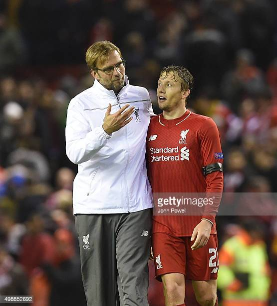Jurgen Klopp manager of Liverpool and Lucas Leiva of Liverpool celebrate at the end of the UEFA Europa League match between Liverpool FC and FC...