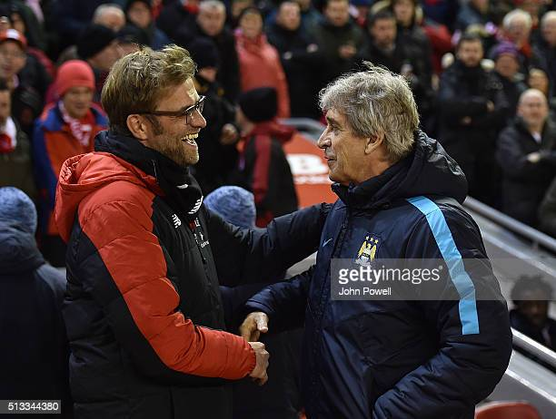Jurgen Klopp manager of Liverpool and Manuel Pellegrini manager of Manchester City hug and shake hands before the Barclays Premier League match...