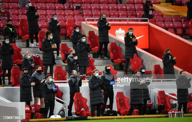 Jurgen Klopp, Manager of Liverpool and members of staff observe a minutes applause in memory of Gerry Marsden, the Gerry And The Pacemakers singer,...