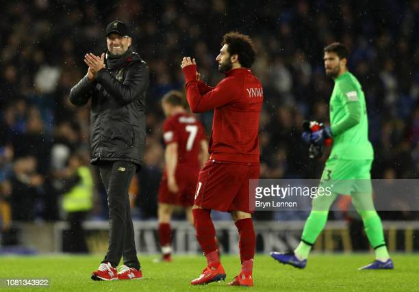 Jurgen Klopp Manager of Liverpool and Mohamed Salah of Liverpool show appreciation to the fans following their sides victory in the Premier League...