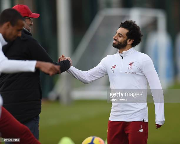 Jurgen Klopp manager of Liverpool and Mohamed Salah of Liverpool during the training session at Melwood Training Ground on March 15 2018 in Liverpool...