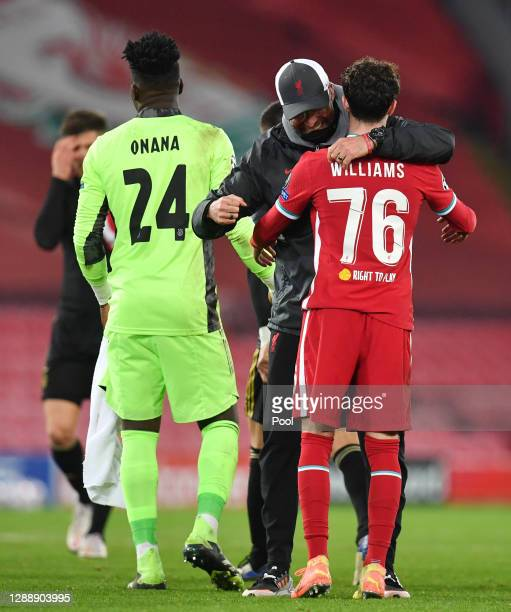 Jurgen Klopp, Manager of Liverpool and Neco Williams of Liverpool celebrate following their team's victory in the UEFA Champions League Group D stage...