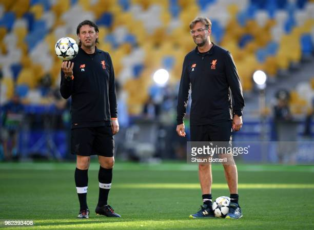 Jurgen Klopp Manager of Liverpool and Peter Krawietz assistant coach of Liverpool look on during a Liverpool training session ahead of the UEFA...
