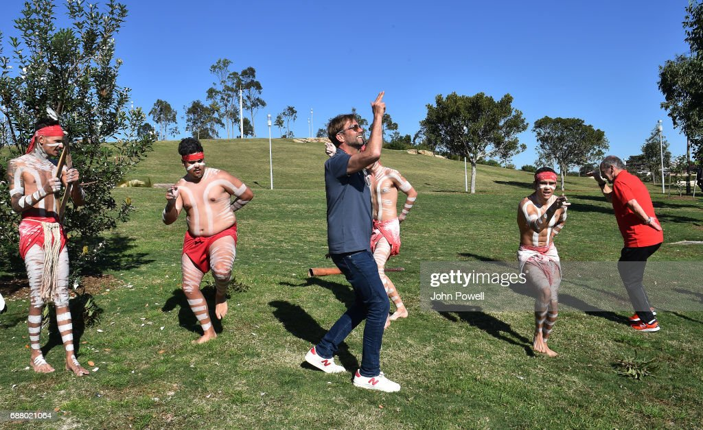 Jurgen Klopp manager of Liverpool and Peter Moore C.E.O of Liverpool perform with the Muggera dancers during a Aboriginal culture tour on Walumil Lawn on May 25, 2017 in Sydney, Australia.