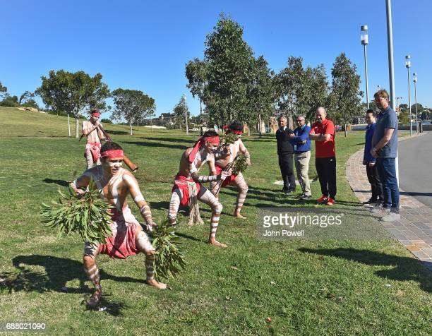 Jurgen Klopp manager of Liverpool and Peter Moore CEO of Liverpool watch the Muggera dancers during a Aboriginal culture tour on Walumil Lawn on May...