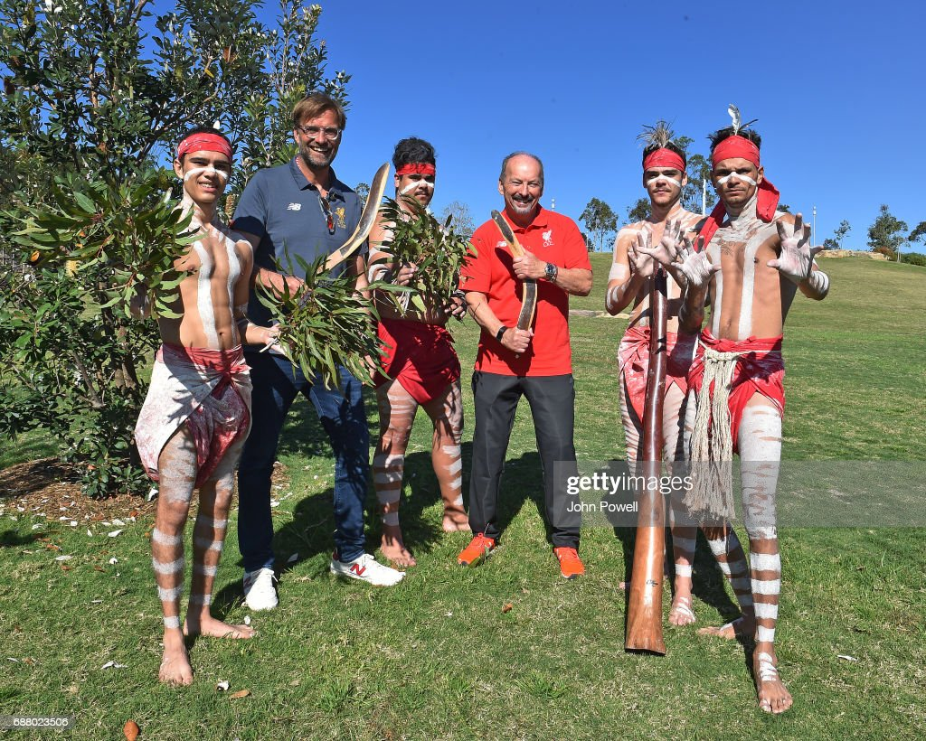 Jurgen Klopp manager of Liverpool and Peter Moore C.E.O of Liverpool pose for a photograph with the Muggera dancers during a Aboriginal culture tour on Walumil Lawn on May 25, 2017 in Sydney, Australia.
