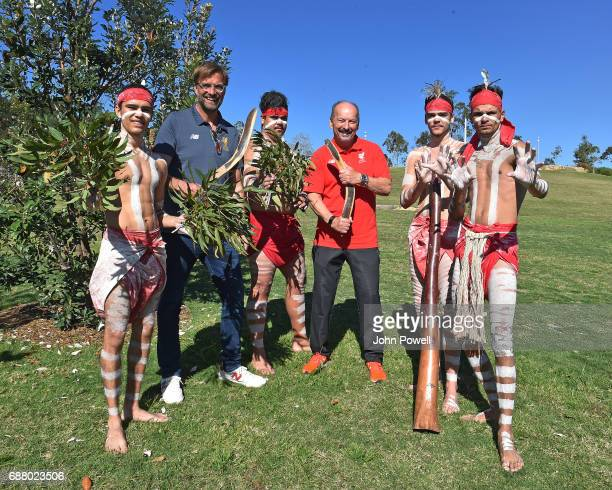 Jurgen Klopp manager of Liverpool and Peter Moore CEO of Liverpool pose for a photograph with the Muggera dancers during a Aboriginal culture tour on...