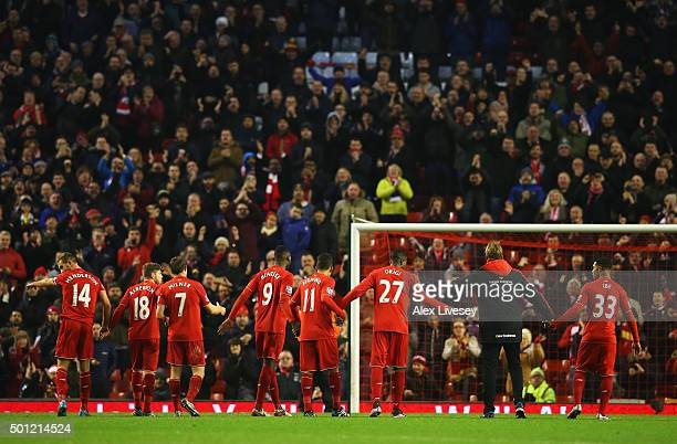 Jurgen Klopp, manager of Liverpool and player salute The Kop after the Barclays Premier League match between Liverpool and West Bromwich Albion at...