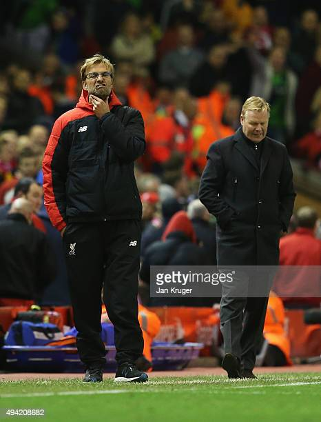 Jurgen Klopp manager of Liverpool and Ronald Koeman manager of Southampton react after the final whistle in the Barclays Premier League match between...