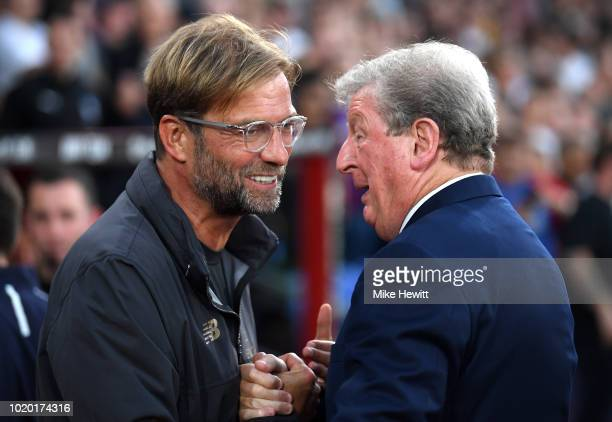 Jurgen Klopp Manager of Liverpool and Roy Hodgson Manager of Crystal Palace shake hands during the Premier League match between Crystal Palace and...