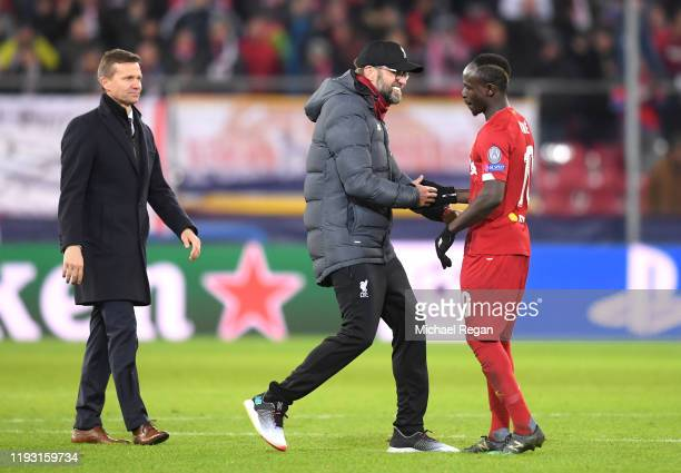 Jurgen Klopp Manager of Liverpool and Sadio Mane of Liverpool embrace during the UEFA Champions League group E match between RB Salzburg and...