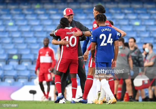Jurgen Klopp Manager of Liverpool and Sadio Mane of Liverpool celebrate following their team's victory in the Premier League match between Chelsea...