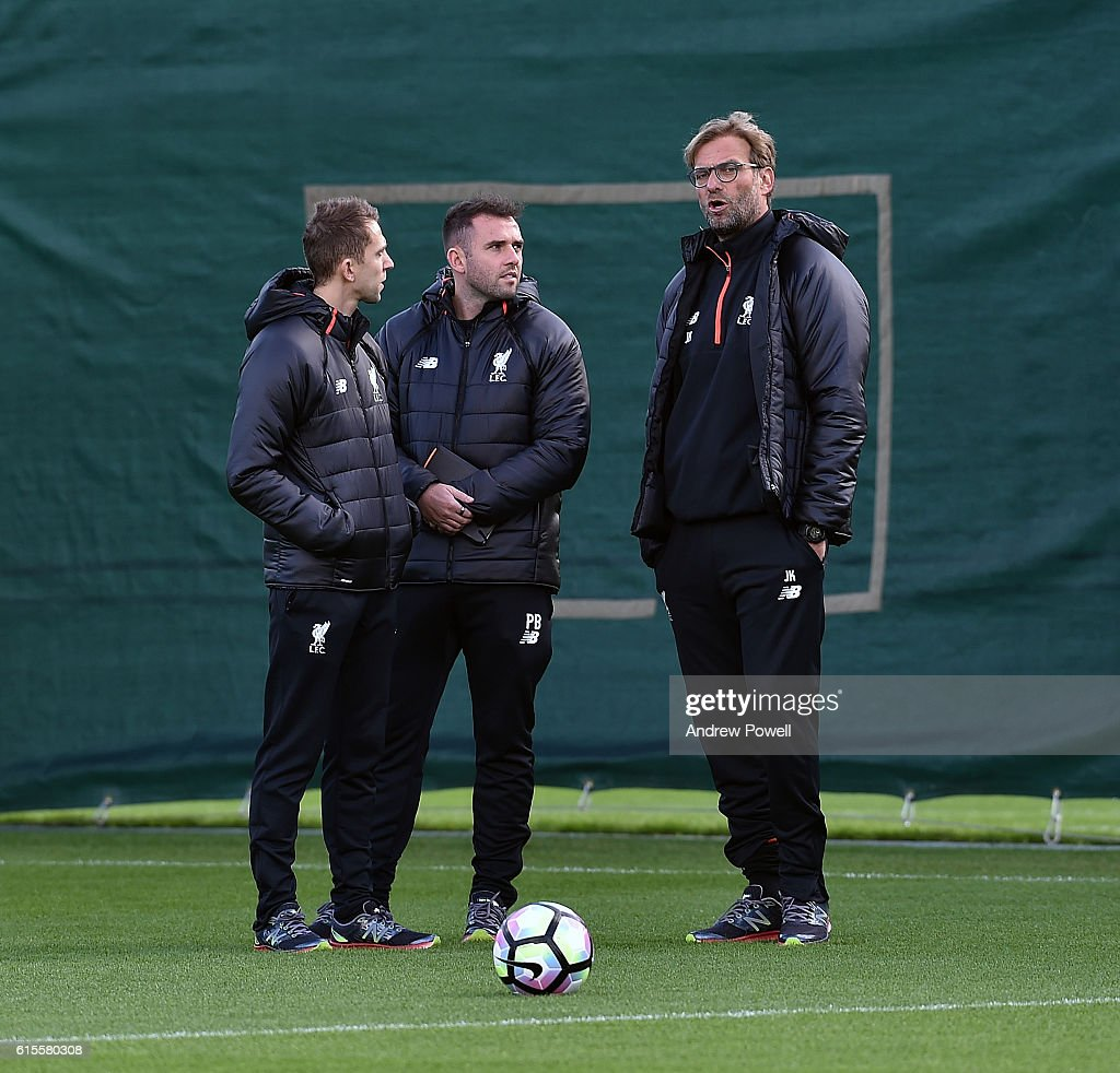 Jurgen Klopp manager of Liverpool and Scott Rogers manager of Liverpool Ladies during a training session at Melwood Training Ground on October 19, 2016 in Liverpool, England.