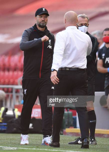 Jurgen Klopp Manager of Liverpool and Sean Dyche Manager of Burnley fist bump following the Premier League match between Liverpool FC and Burnley FC...
