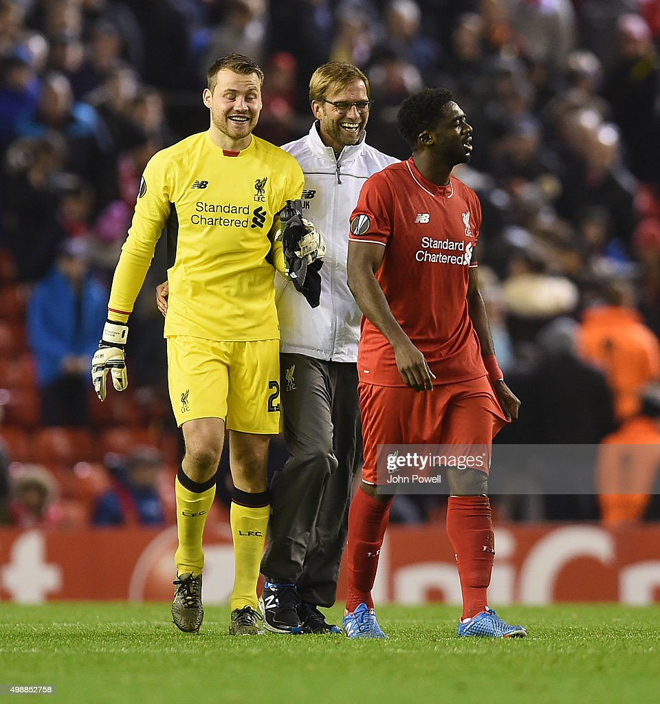 Jurgen Klopp manager of Liverpool and Simon Mignolet of Liverpool and Kolo Toure celebrate at the end of the UEFA Europa League match between Liverpool FC and FC Girondins de Bordeaux on November 26, 2015 in Liverpool, United Kingdom.