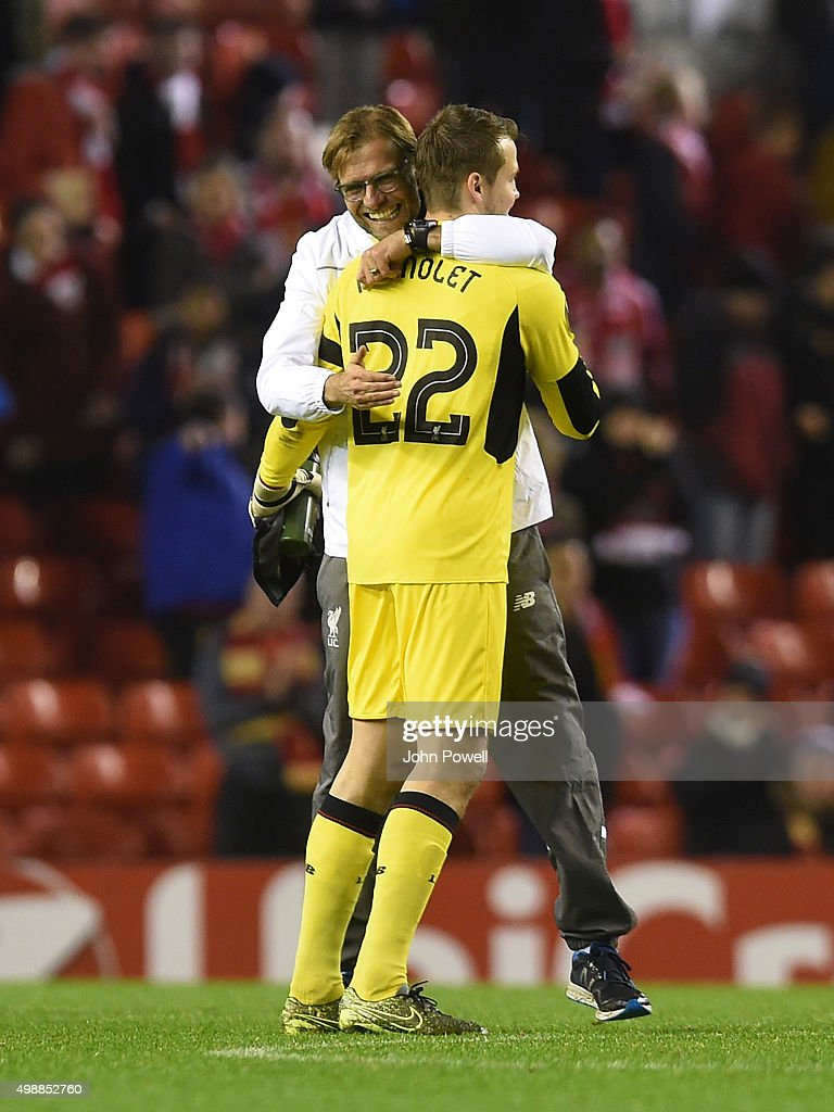 Jurgen Klopp manager of Liverpool and Simon Mignolet of Liverpool celebrate at the end of the UEFA Europa League match between Liverpool FC and FC Girondins de Bordeaux on November 26, 2015 in Liverpool, United Kingdom.