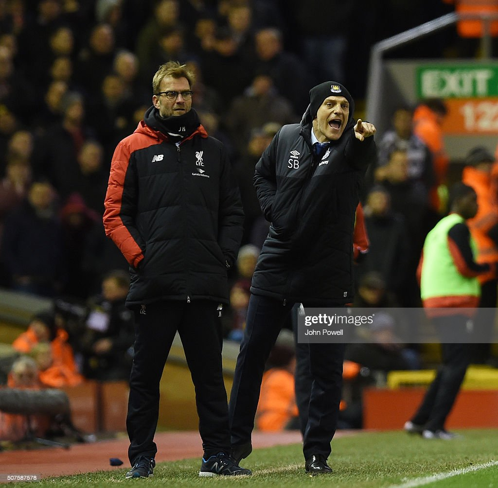 Jurgen Klopp manager of Liverpool and Slaven Bili of West Ham United react during The Emirates FA Cup Fourth Round between Liverpool and West Ham United at Anfield on January 30, 2016 in Liverpool, England.