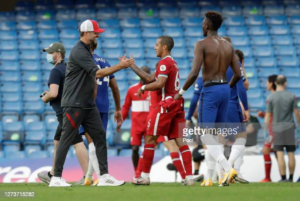 Jurgen Klopp Manager of Liverpool and Thiago Alcantara of Liverpool celebrate following their team's victory in the Premier League match between...