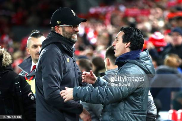 Jurgen Klopp Manager of Liverpool and Unai Emery Manager of Arsenal shake hands during the Premier League match between Liverpool FC and Arsenal FC...