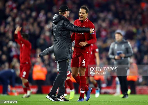 Jurgen Klopp Manager of Liverpool and Virgil van Dijk of Liverpool celebrate victory following the Premier League match between Liverpool FC and...