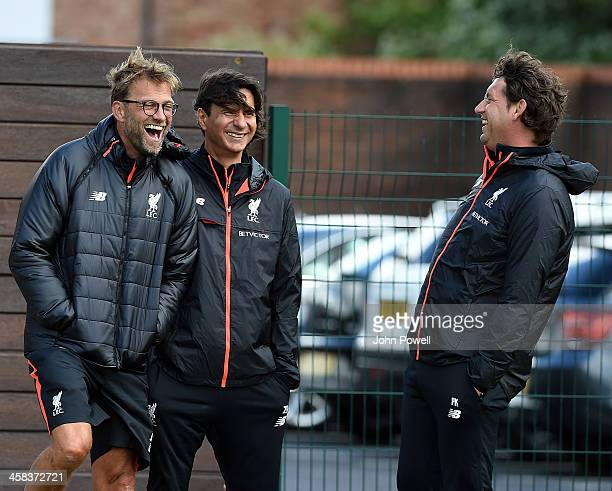 Jurgen Klopp manager of Liverpool and Zeljko Buvac first team coach of Liverpool and Peter Krawietz Second Assistant Coach of Liverpool during the...
