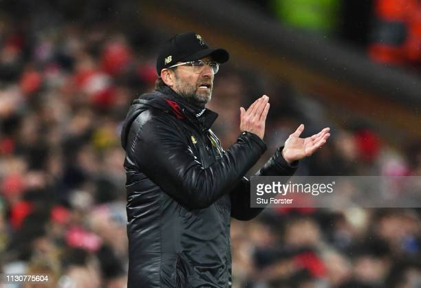 Jurgen Klopp Manager of Liverpool applauds during the UEFA Champions League Round of 16 First Leg match between Liverpool and FC Bayern Muenchen at...