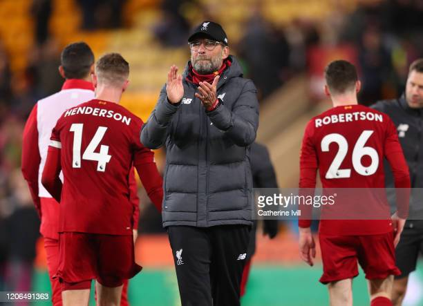 Jurgen Klopp Manager of Liverpool applauds fans after the Premier League match between Norwich City and Liverpool FC at Carrow Road on February 15...