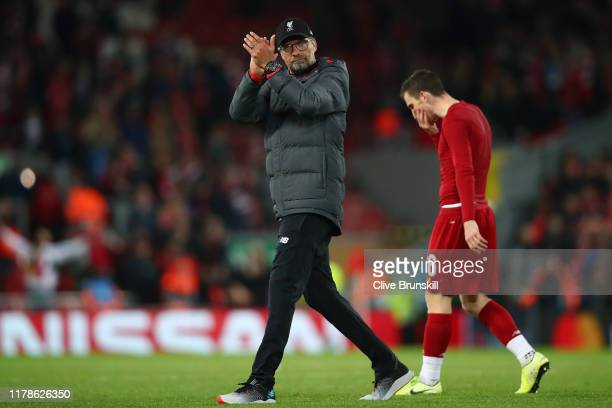 Jurgen Klopp Manager of Liverpool applauds fans during the UEFA Champions League group E match between Liverpool FC and RB Salzburg at Anfield on...
