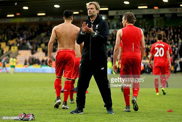 Jurgen Klopp manager of Liverpool applauds the away supporters after his team's 54 win in the Barclays Premier League match between Norwich City and...