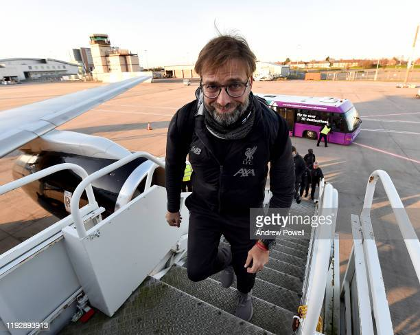 Jurgen Klopp manager of Liverpool boarding the plane ready to depart for Salzburg at Liverpool John Lennon Airport on December 09 2019 in Liverpool...