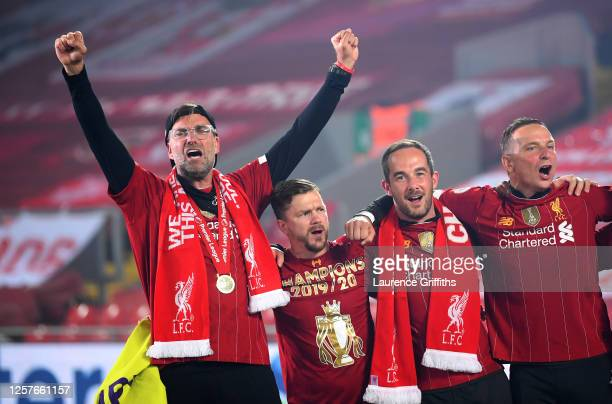 Jurgen Klopp Manager of Liverpool celebrate with members of his backroom staff following the Premier League match between Liverpool FC and Chelsea FC...