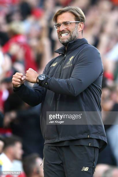 Jurgen Klopp Manager of Liverpool celebrates after Mohamed Salah of Liverpool scores his team's first goal during the Premier League match between...