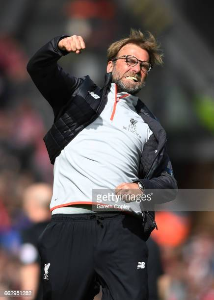 Jurgen Klopp Manager of Liverpool celebrates after the Premier League match between Liverpool and Everton at Anfield on April 1 2017 in Liverpool...