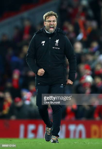 Jurgen Klopp Manager of Liverpool celebrates after the Premier League match between Liverpool and Leicester City at Anfield on December 30 2017 in...