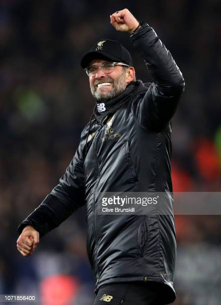 Jurgen Klopp Manager of Liverpool celebrates after the UEFA Champions League Group C match between Liverpool and SSC Napoli at Anfield on December 11...
