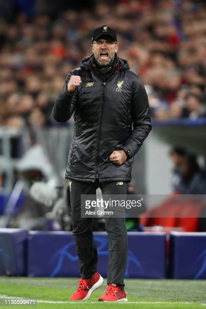 Jurgen Klopp Manager of Liverpool celebrates as Sadio Mane scores his team's first goal during the UEFA Champions League Round of 16 Second Leg match...