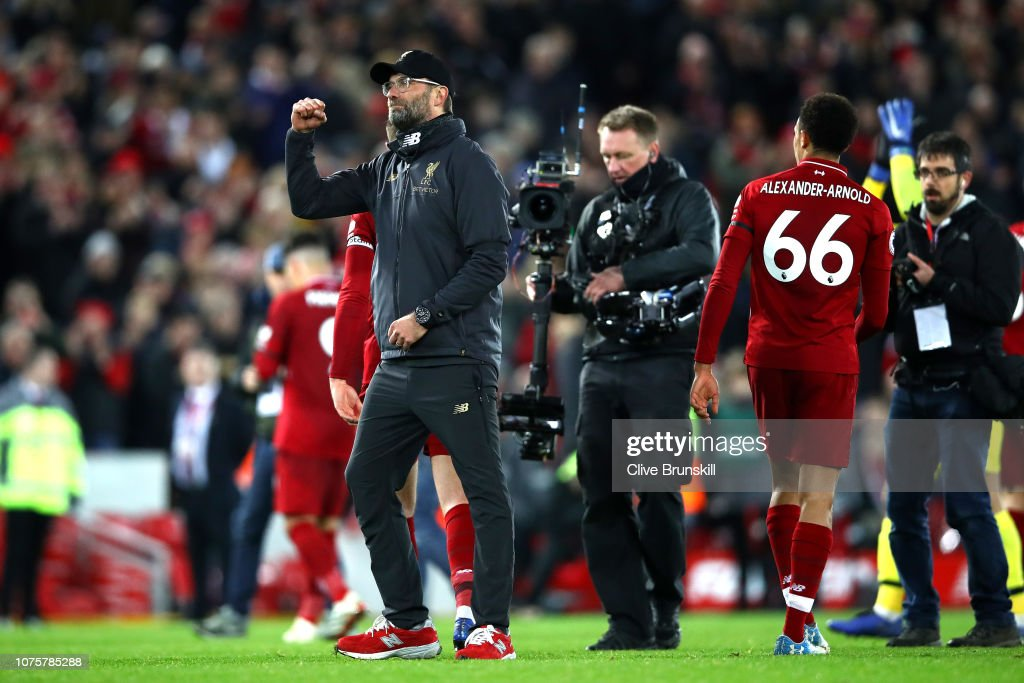 https://media.gettyimages.com/photos/jurgen-klopp-manager-of-liverpool-celebrates-during-the-premier-picture-id1075785288