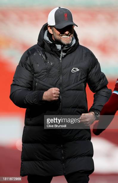 Jurgen Klopp, Manager of Liverpool celebrates following the Premier League match between Liverpool and Aston Villa at Anfield on April 10, 2021 in...
