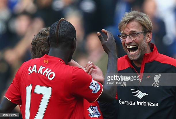 Jurgen Klopp , manager of Liverpool celebrates his team's 3-1 win with his player Mamadou Sakho after the Barclays Premier League match between...
