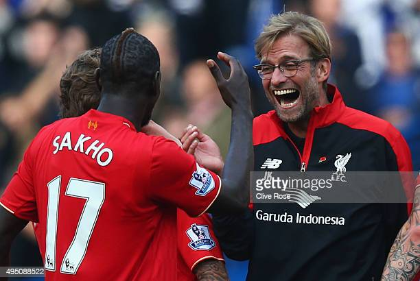 Jurgen Klopp manager of Liverpool celebrates his team's 31 win with his player Mamadou Sakho after the Barclays Premier League match between Chelsea...