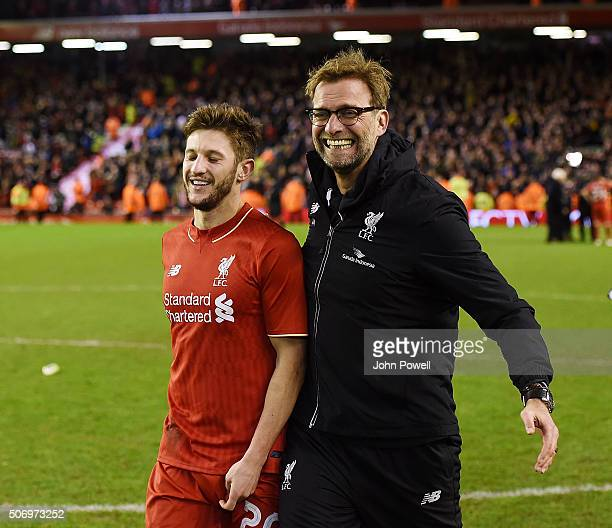Jurgen Klopp manager of Liverpool celebrates the win with Adam Lallana at the end of the Capital One Cup Semi Final Second Leg between Liverpool and...