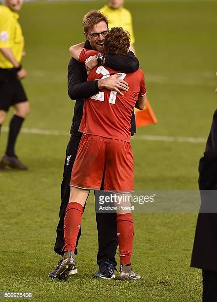 Jurgen Klopp manager of Liverpool celebrates the win with Lucas Leiva at the end of the Capital One Cup Semi Final Second Leg between Liverpool and...