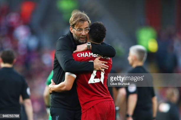 Jurgen Klopp Manager of Liverpool celebrates victory with Alex OxladeChamberlain of Liverpool after the Premier League match between Liverpool and...