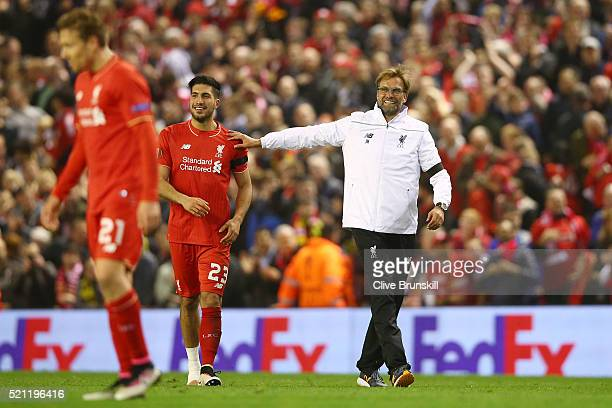Jurgen Klopp manager of Liverpool celebrates victory with Emre Can after the UEFA Europa League quarter final second leg match between Liverpool and...