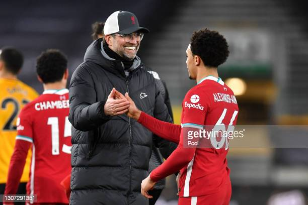 Jurgen Klopp, Manager of Liverpool celebrates victory with Trent Alexander-Arnold of Liverpool following the Premier League match between...