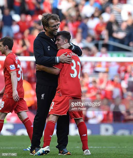 Jurgen Klopp manager of Liverpool celebrates with Cameron Brannagan of Liverpool at the end of the Barclays Premier League match between Liverpool...